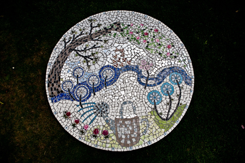 Mosaic table top with garden theme