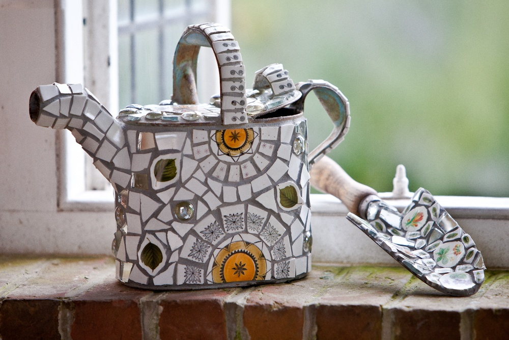 Retro watering can & trowel with vintage ceramic mosaic
