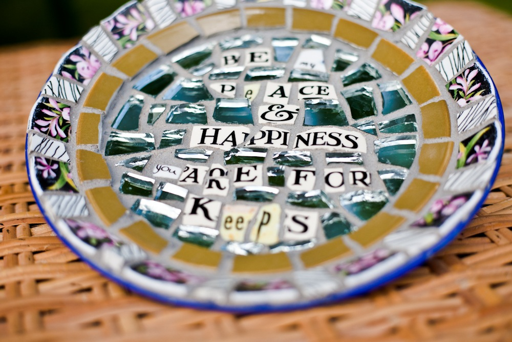Enamel plate with text in vintage ceramic mosaics
