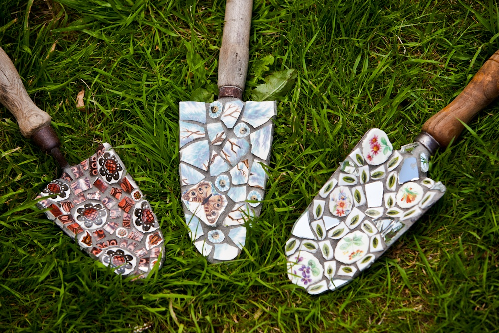 Vintage garden trowels decorated in retro crockery mosaic