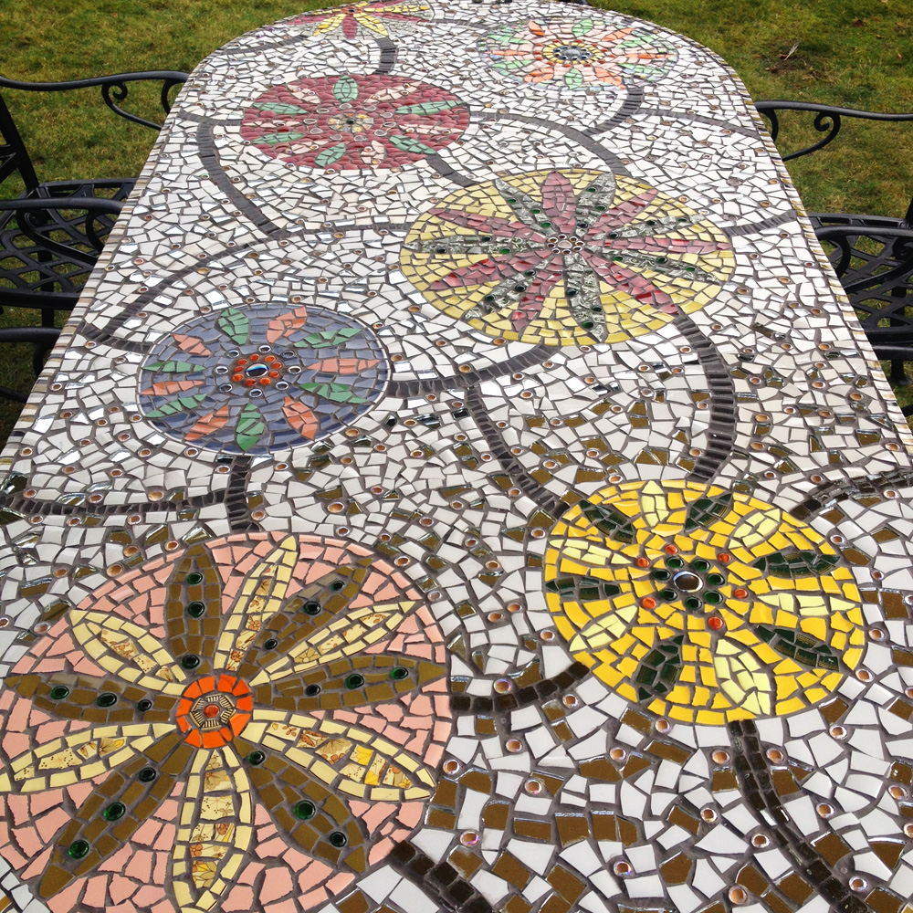 Mosaic garden table using vintage crockery, mirror, glass beads and buttons